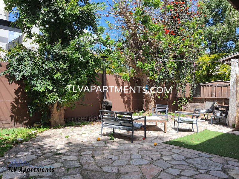 Villa with a large green garden
